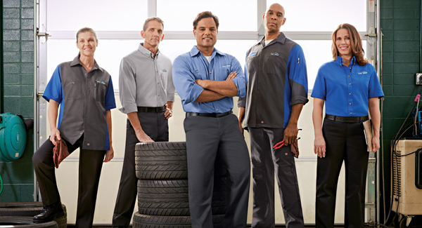 This is a picture of a team wearing automotive uniforms