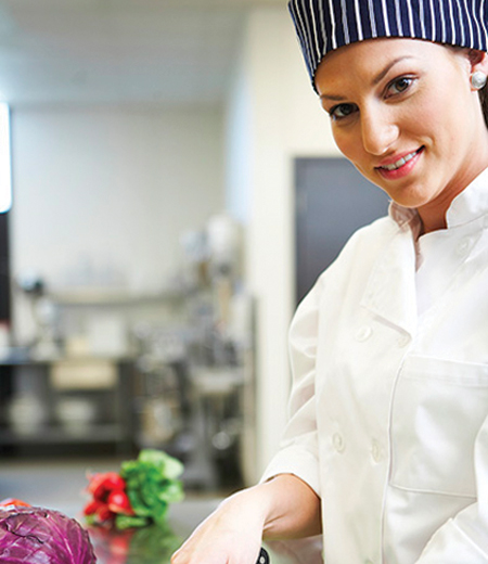 This is a photo of an employee in a chefs uniform