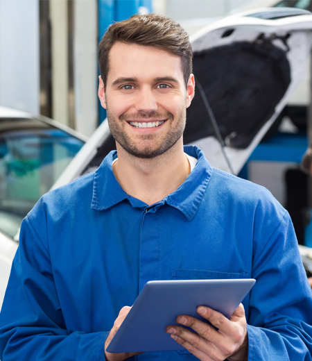 This is a photo of an employee in an automotive uniform